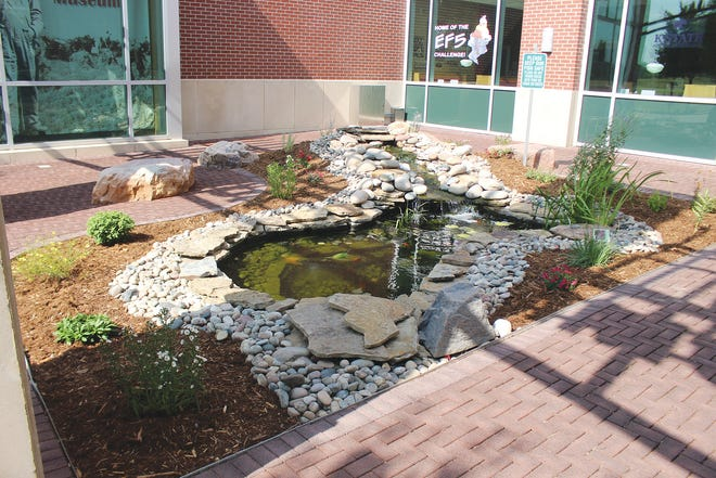 Gurgling waterfalls and pleasant flowers greet visitors to one of Kiowa County's community buildings on S. Main in Greensburg.
