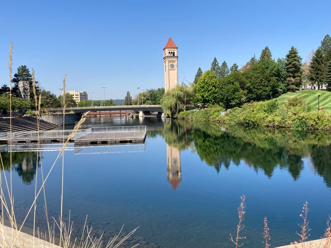 Tranquil Spokane River frames the Great Northern Railway tower in Riverfront Park.