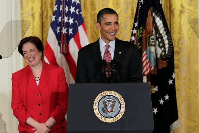 President Barack Obama joins Elena Kagan for a ceremony to mark her confirmation to become the next Supreme Court justice on Aug. 4, 2010, in the East Room of the White House. Kagan was the first Supreme Court nominee in nearly 40 years with no experience as a judge, and her addition marked the first time that three women would serve on the nine-member court together. She was later sworn in as the successor to retired Justice John Paul Stevens.