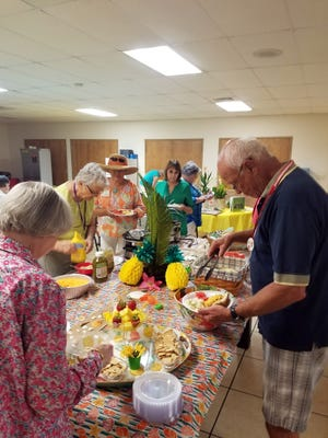 Azalea Garden Club members and attendees enjoy a previous social and welcome event in Pace. The club's next social to open their 2021 season is scheduled.