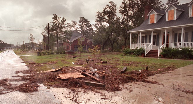 Residents on Shannon Drive along Myrtle Grove sound woke up to debris  driven by storm surge from the intracoastal waterway as Hurricane Floyd passed over New Hanover County.