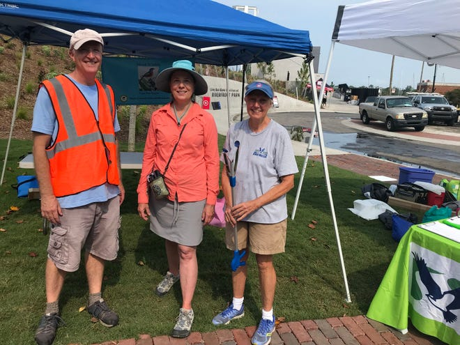 From left, Cape Fear River Watch volunteer Curry Guinn, Virginia Holman of Island Wildlife and Cape Fear River Watch volunteer Sue Allen helped pick up trash in and around Live Oak Bank Pavilion at Riverfront Park on Sunday, Aug. 1.