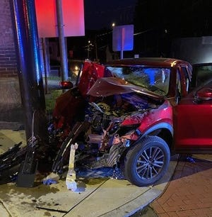 A Mazda SUV sustained heavy damage after it struck a light pole on Main Street in Spencer early Saturday morning. Two teens were seriously injured.