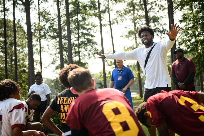 NFL player and Terry Sanford alum Dwayne Allen speaks to the Douglas Byrd football team before Academy Sports + Outdoors surprises the team with a $2,000 gift card on Monday, Aug. 2, 2021.