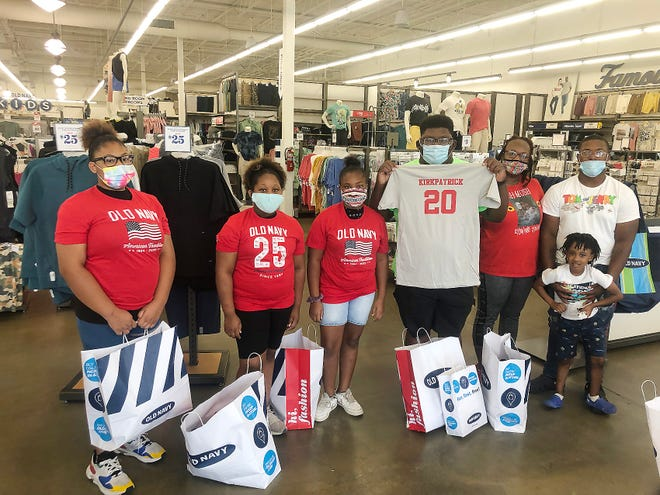 Twenty-seven Gadsden children on Friday got to shop for shoes and clothing at Shoe Carnival and Old Navy, courtesy of football player Dre Kirkpatrick's 21 Kids Foundation and other community partners.