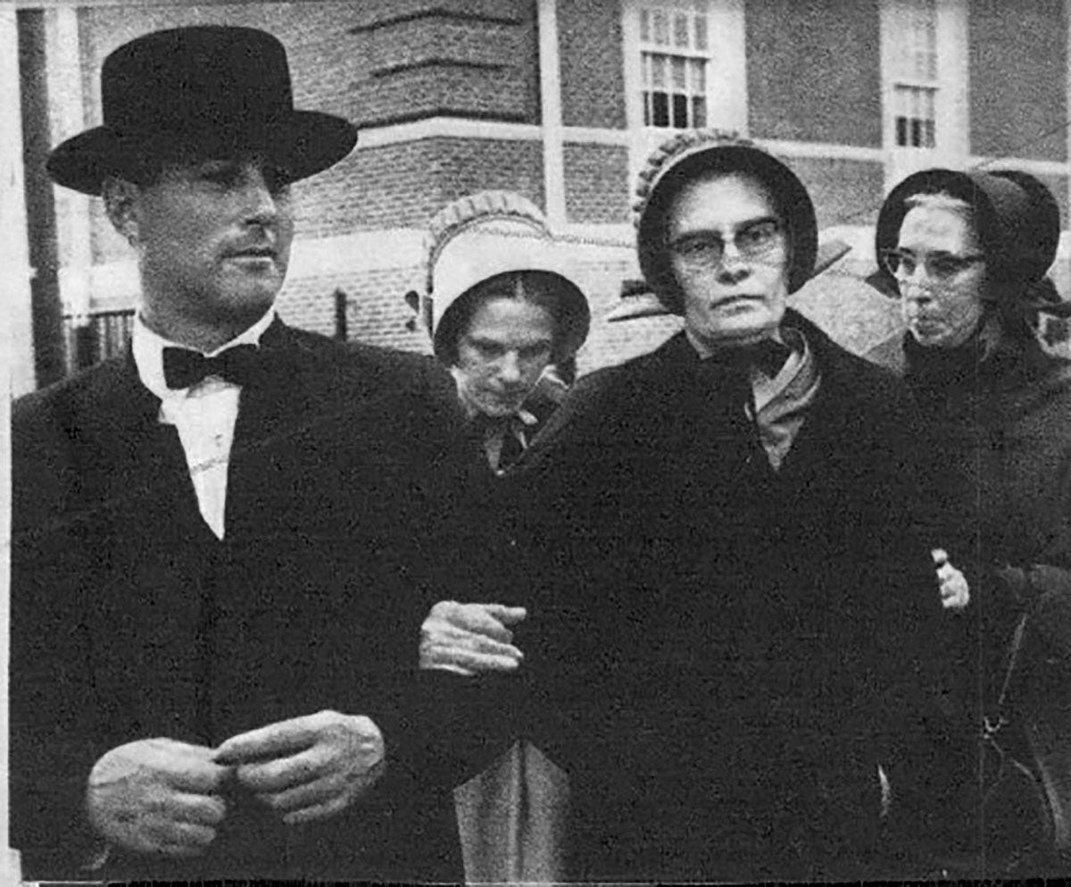 Patty Bear's mother, Gale Bear, pictured in the back with her head bowed, at the court appearance involving Gale's husband Robert Bear (not pictured).