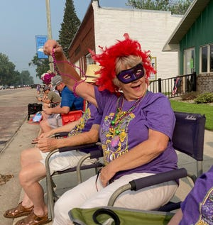 Julie Anderson from Idaho shows off her beads Saturday during the 30th annual Honey Days Parade in Bruce.