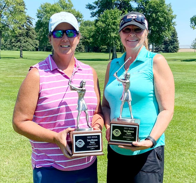 Amy Nawroth, left, and Mary Wheeler-Neuroth of Watertown repeated as the Open Division champions over the weekend in the South Dakota Golf Association's Two-Woman Championship at the Brookings Country Club.