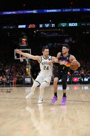 St. John's Prep alumnus Pat Connaughton (24) often drew the toughest defensive assignment during the NBA Finals, guarding All-Stars like Devin Booker, above, or future Hall of Famer Chris Paul.