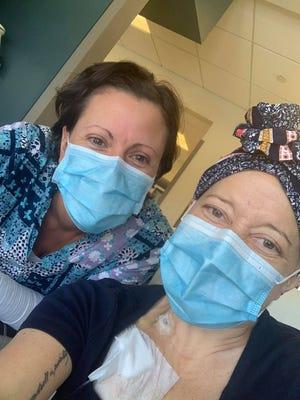 Cancer survivor Heidi Richard, right, and her nurse Jodi Darby  trained for the Hartford Half Marathon together in the halls of UMass Memorial Medical Center while Richard underwent treatment.