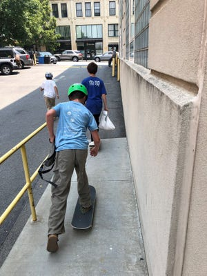Generally speaking, skateboarding is prohibited in downtown Asheville, and private property owners can ban it on their property. These kids were skateboarding by the Citizen Times building in July 2021.