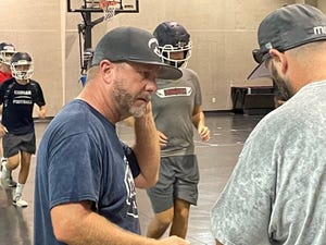 New Merritt Island Christian head football coach Matt Handwork directs practice after weather chased the team inside on Monday, Au. 2, 2021.