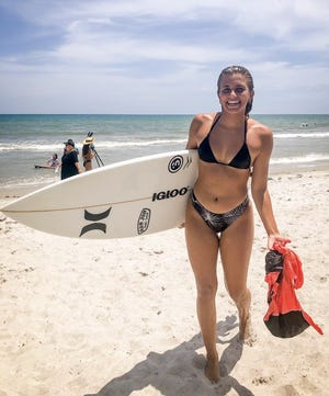 Zoe Benedetto of Palm City walked off with the $500 top prize in the girls Jr. Pro division of the inaugural Space Coast Gromfest on Cocoa Beach.