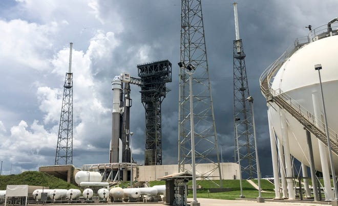 Boeing's CST-100 Starliner capsule sits atop a ULA Atlas V rocket as thunderstorms move in on Complex 41 at Cape Canaveral Space Force Station Monday, August 2, 2021. The rocket was scheduled to launch Tuesday on a test mission to the International Space Station but scrubbed due to a technical issue.