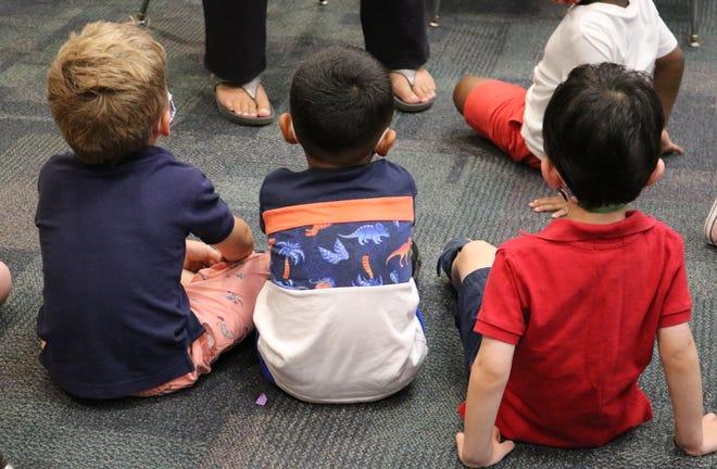 Preschoolers enjoy listening to a story during an Extended School Year (ESY) program of Westfield Public Schools.