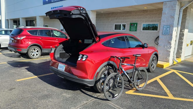 To get back and forth from a Ford dealer's charger in Charlevoix while the 2021 Ford Mustang Mach-E juiced up overnight, Payne had to bring along a bicycle. Trip on bike? About 40 minutes round trip from Payne's cottage.