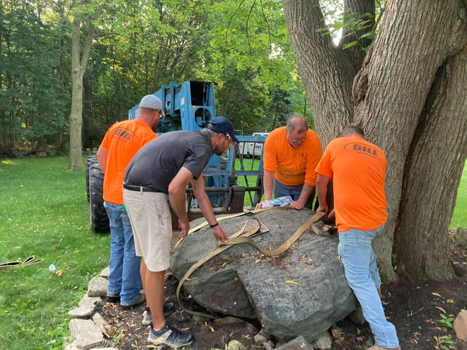 Workers preparing to move the Kaptain's Indian Grinding Rock.