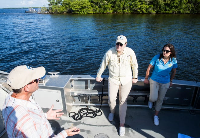 James Evans, the director of environmental policy at the Sanibel Captiva Conservation Foundation speaks with Florida Agriculture Commissioner Nikki Fried and Ryan Orgera, the CEO of the Sanibel Capitiva Conservation during brief tour of the Caloosahatchee estuary. Fried was in Southwest Florida to announce changes and updates to the departments agricultural water policies.