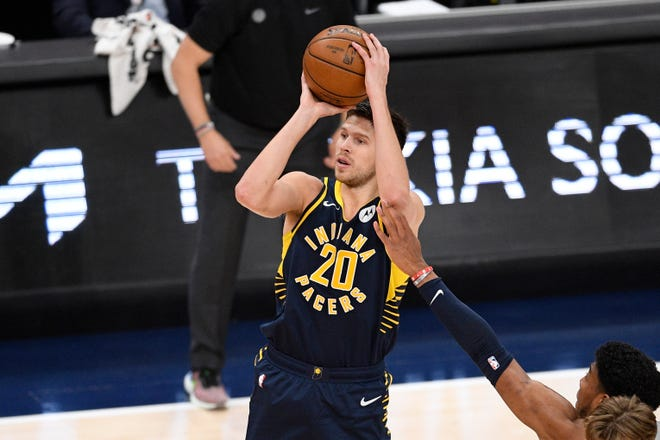Indiana Pacers forward Doug McDermott (20) shoots during the second half of an NBA basketball Eastern Conference play-in game against the Washington Wizards, Thursday, May 20, 2021, in Washington. (AP Photo/Nick Wass)