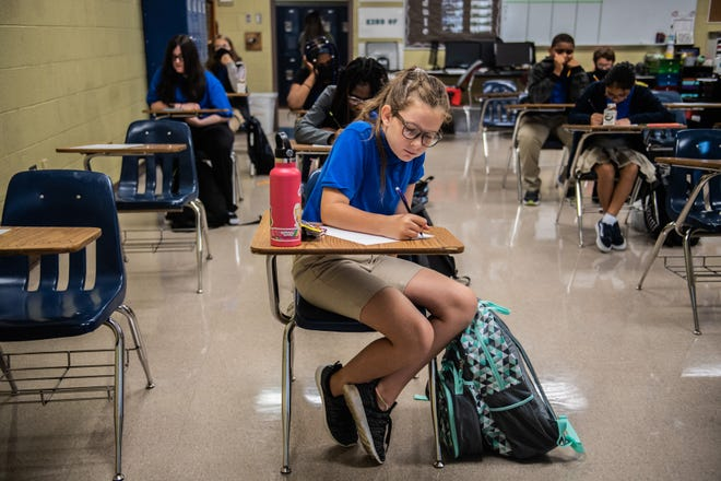 """6th graders, Kayden Smith, 11, fills out an """"About Me"""" sheet for her math and science class on the first day of classes at West Bemis Middle school on Monday, Aug 2, 2021 in Jackson, Tenn."""