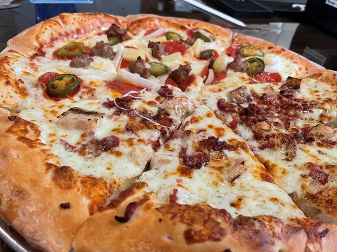This half-and-half pizza at Pizza Hoss is a hybrid of the BadMamaJama and a chicken-bacon-ranch concoction.