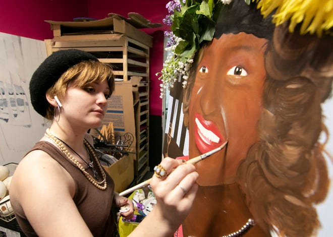 """15-year-old Vivian Combs, a junior at Brighton's FlexTech High School, works on an oil color and mixed media painting she expects to entitle """"Marsha,"""" a depiction of LGBTQ+ activist Marsha P. Johnson, at the Art Learning Center and Gallery in Pinckney Monday, Aug. 2, 2021. Combs not only uses the new artists' space as a studio, but also teaches there."""