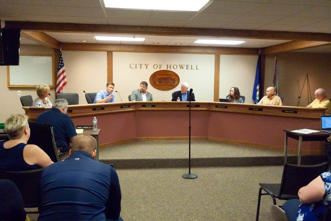 The Howell City Council met in a special session Friday, July 30, 2021 to discuss whether to cancel the MelonFest amid controversy surrounding a Drag Queen Bingo event held during the festival. From left are Mayor Pro-Tem Jan Lobur, city attorney Dennis Perkins (with back to camera), Nikolas Hertrich, City Manager Ervin Suida, Mayor Nick Proctor, Jeannette Ambrose, Dr. Robert Ellis and Steven Manor.