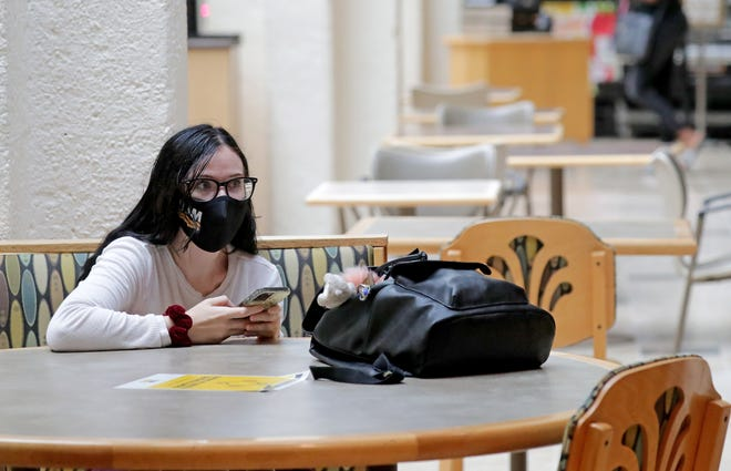 Teresa Scott, a sophomore from Milwaukee majoring in photography, sits in the student union on the University of Wisconsin-Milwaukee campus on Monday. Colleges across the state are working to reevaluate on-campus masking policies in the weeks leading up to the start of the fall semester.