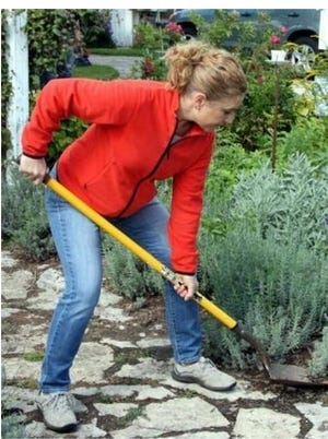 Long-handled gardening tools can help maintain a straighter posture, as shown by Stephanie Wahlen.