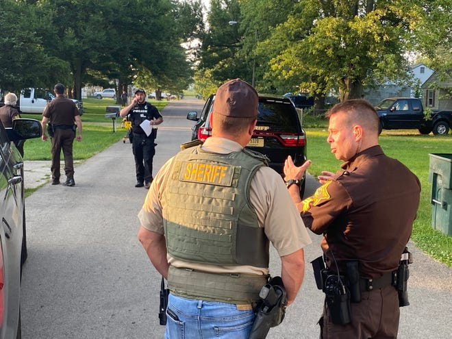 Delaware County sheriff's deputies and Muncie police officers on Sunday evening were in the Aultshire Park neighborhood, where a local man was arrested after allegedly fleeing on foot from the scene of a traffic accident, then stealing another vehicle.