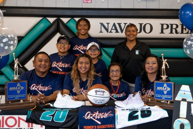 Aiona Johnson (second from left) is pictured with her family after signing on to play women's basketball and attend Pima Community College in Tucson, Arizona
