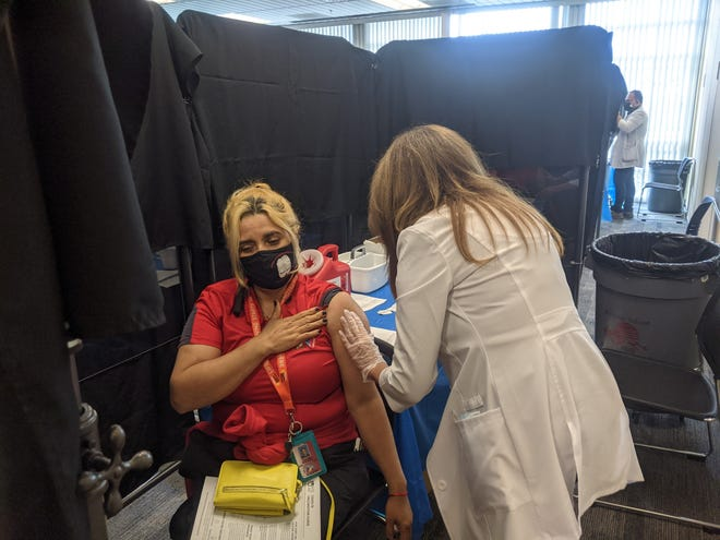 People get vaccinated at the Palm Springs Unified School School District's vaccination clinics in the spring of 2021.