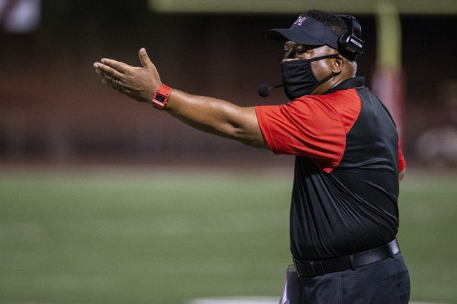 Maricopa head coach Brandon Harris gestures to referees during the first half against Willow Canyon on Oct. 1, 2020, at Maricopa High School in Maricopa, Ariz.