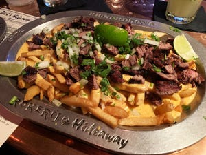 The carne asada fries at Dick's Hideaway are three times the size of your regular appetizer.