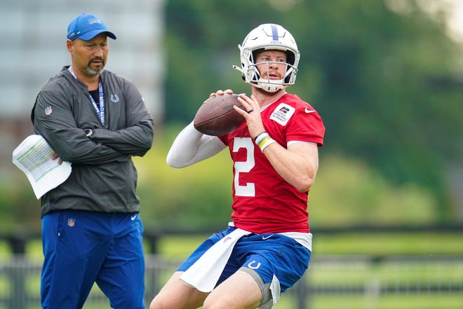 Indianapolis Colts quarterback Carson Wentz runs a drill during practice at the NFL team's football training camp in Westfield, Ind., Thursday, July 29, 2021. (AP Photo/Michael Conroy)