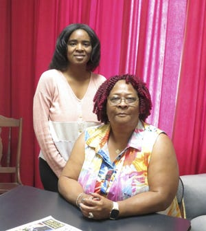 Museum Education student Joyce Jefferson, standing, with Jennie Jones, seated. Jones' oral history was recorded this June 19th (Juneteenth). Jones graduated in the Shadeville High class of 1963, and brought photos and a Shadeville High reunion program, which the Museum scanned for digital preservation.