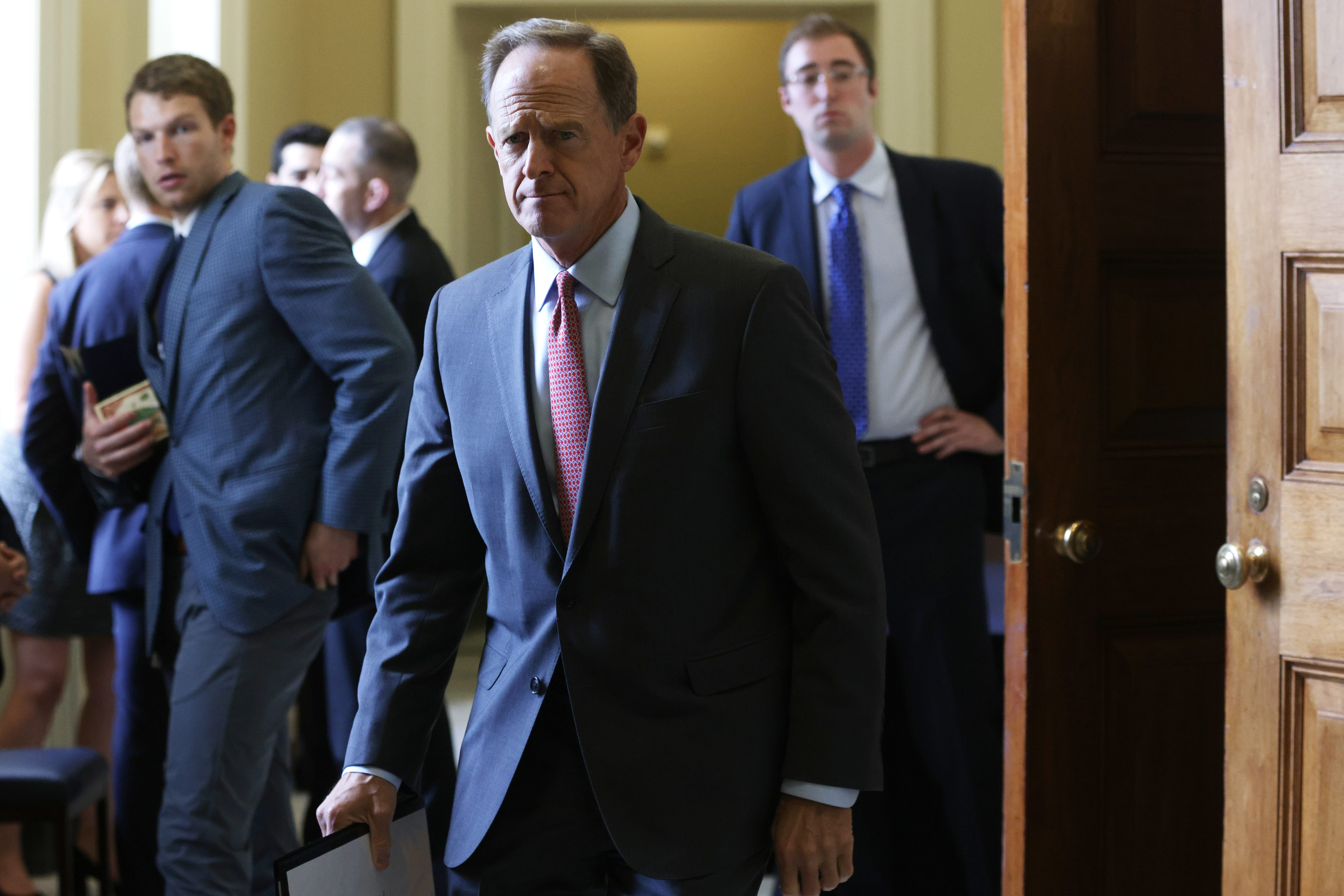Sen. Pat Toomey, R-Pa., leaves after a Senate Republican luncheon at the U.S. Capitol on July 28, 2021 in Washington, D.C.
