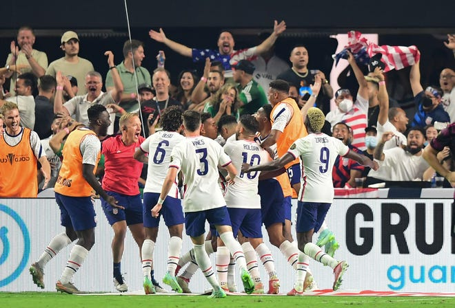 Fans and the USMNT celebrate after Miles Robinson scored the winning goal against Mexico in the Gold Cup final at the Allegiant stadium in Las Vegas.