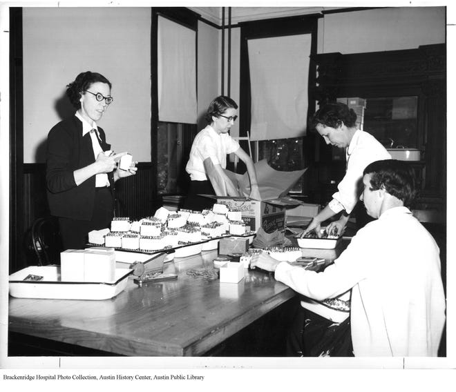 This photo from the 1950s shows Austin Health Department staff preparing polio vaccines for mass inoculations. Photo credit: Brackenridge Hospital Photo Collection, Austin History Center, Austin Public Library.