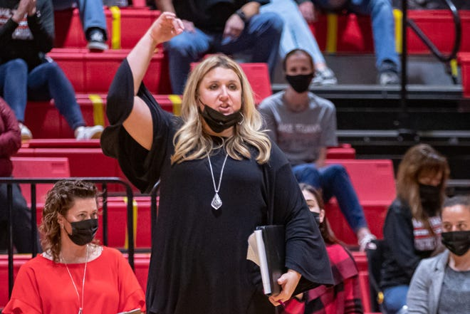 Lake Travis volleyball coach Brandace Boren gives instructions to her team during a playoff win over San Antonio Clark last season. Boren led the Cavs to their first outright Class 6A district title and compiled a perfect regular season for the first time since the 2011 team won a Class 4A state championship.