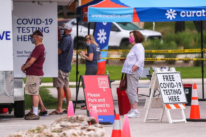 Georgetown, Texas residents wait in line at a mobile COVID-19 testing site near the Georgetown Public Library on Aug. 3, 2021.