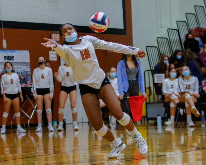 Westwood outside hitter Peyton Ferree makes a one-handed return hit against Cedar Ridge last season. Ferree returns as one of several all-district players for the Warriors.