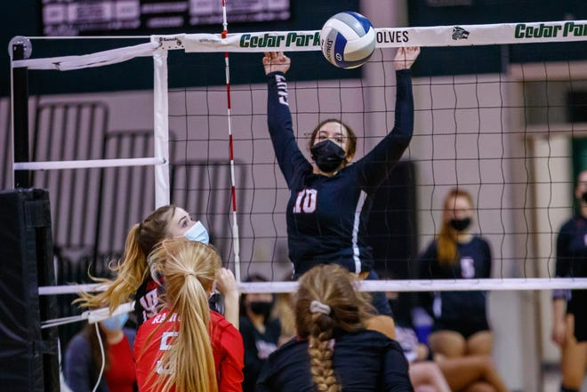 Lake Travis Cavaliers setter Kiana Reed blocks a shot in a playoff game against Vista Ridge last season. The all-Centex setter returns as part of a loaded Lake Travis volleyball team.
