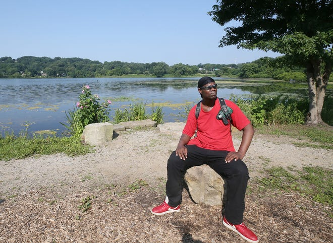 James Palm talks about his tax situation July 28 as he sits along the shoreline of Summit Lake in Akron. Community Legal Aid is suing the state for double taxing employees who don't have a W-2. Some, like James Palm, never got one after the company they worked for went out of business.
