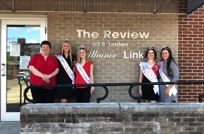 2021 Greater Alliance Carnation Festival queen Torrie Forrest, second from left, and her court, second from left, First Attendant Madeline Davis; Second Attendant; Second Attendant and Miss Congeniality Bethany Caruthers; and Third Attendant Leah Springer, took part in their tour of the city after taking their posts to lead the festival. Among the first stops was at The Alliance review, where they met with Editor Laura Kessel, far left.