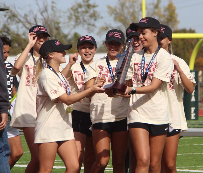 The Plainview girls track and field team celebrates a state championship last season. The Lady Indians were one of many southern Oklahoma squads that won a title during the 2020-21 campaign.