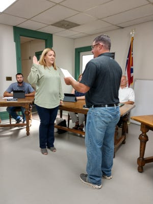 Mayor Jasdon VanSickle administers the oath of office to the newest Loudonville council member, Hollie McCauley.