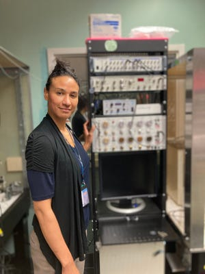 Dr. Alexis Stranahan, associate professor in the Department of Neuroscience and Regenerative Medicine at Augusta University, with her electrophysiology machine she uses to test brain function. Her new study looks at how different fat affects the brain, in good ways as well as bad.