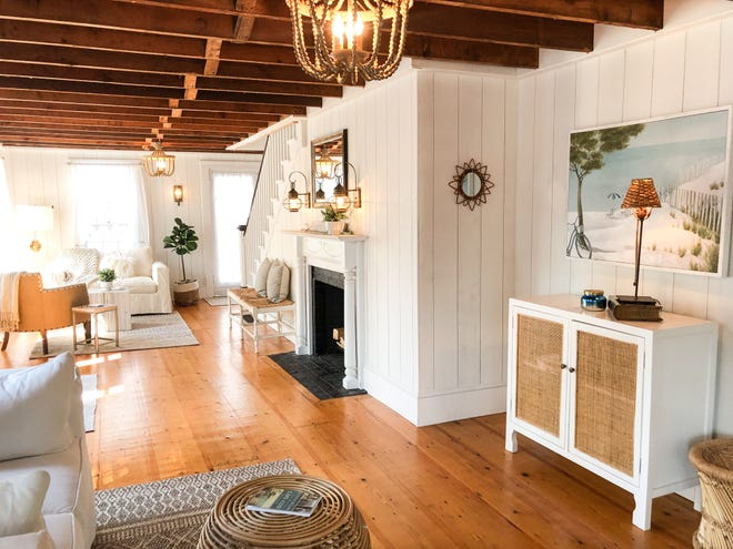 Beamed ceilings and wide pine floors give this home an airy feel.