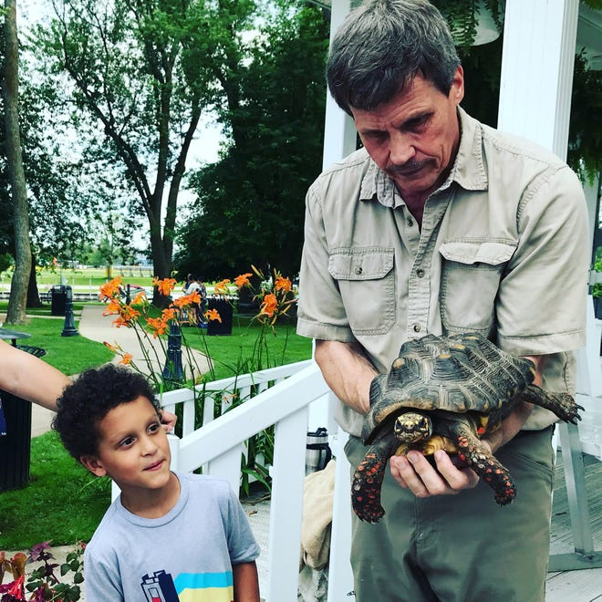 John Oliver from Dynamic West Assemblies brought several animal friends with him to Washington Park to show the children and their families, including Stella, the red footed tortoise.